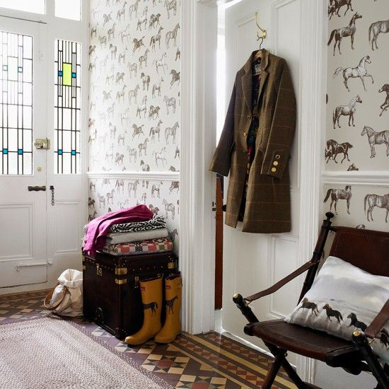 The equestrian lifestyle has spilled into the front hallway of this family's London townhouse. They meant for it to be contained at their country residence but alas, their efforts were futile. ;):