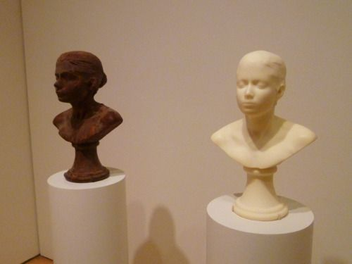 """Janine Antoni's creepy pair of self-portrait sculptures """"Lick and Lather"""" (1993-94), one made of chocolate and the other of soap."""