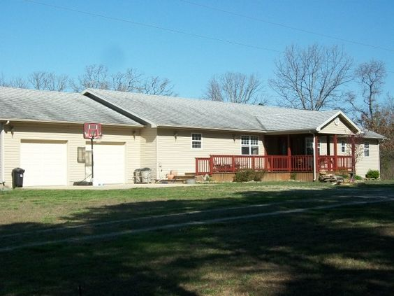 This 3 bedroom 2.5 bath home sits on 29 m/l picturesque acres of Ozarks wonder. Home built in 2009, kitchen has oak cabinets and tile countertops, large dining area, Comfortable livingroom with woodstove to take the chill off on those cooler Ozark mornings. Master Bedroom has master bath with jacuzzi tub and walk in closet. Outside has 6 m/l cleared acres, including apple, plum and persimmon trees. The remaining acreage shows off true Ozarks beauty. Walking and hiking trails in Licking MO