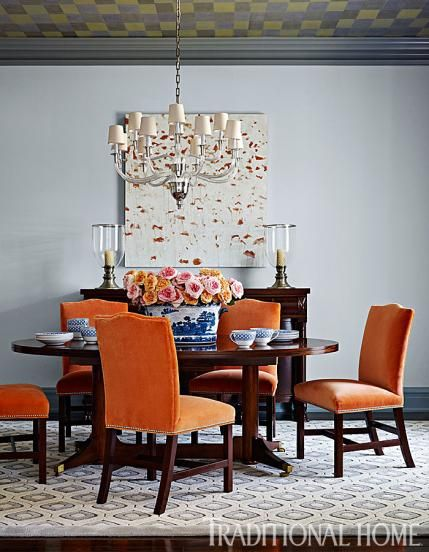 Fearless color abounds in this dining room with orange for Light blue dining room ideas