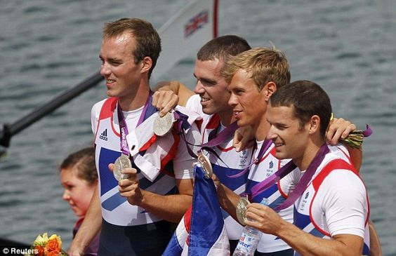 Britain's Peter Chambers, Rob Williams, Richard Chambers and Chris Bartley smile with their silver medals after finishing a very close second in the men's lightweight four rowing