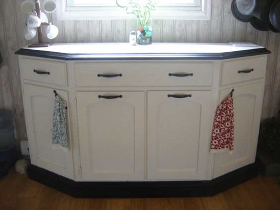 """Here it is done.  Since I don't have Cija here close, my Amish neighbor did the carpentry.  We popped off the top and added 6"""" of height in the form of three drawers.  He took off the hideous doors, brought the face out so it would look good, and made new doors to match my kitchen."""