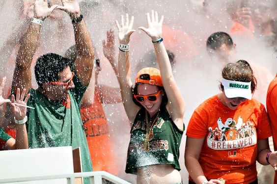 Miami Hurricanes student section gets sprayed with smoke after the end of the first quarter