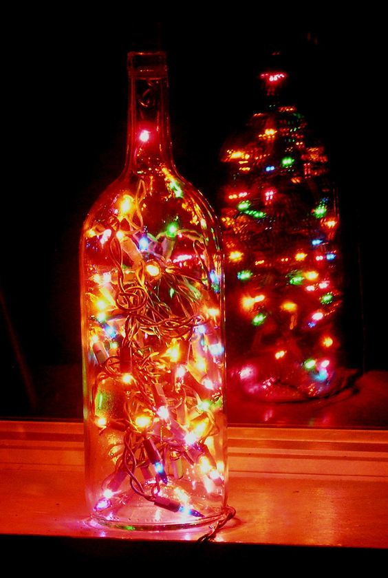 Clear wine bottle light with multi colored lights ideas for Colored bottles for decorations