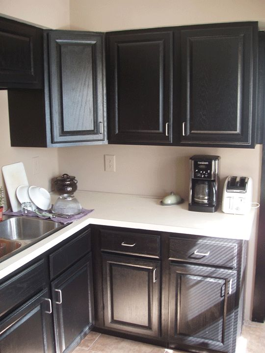 Black cabinets cabinets and painting cabinets on pinterest for Best bonding primer for kitchen cabinets