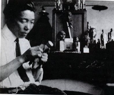 Seizo Sugawara, a known decorative lacquer artist from Japan.  Eileen Gray met Sugawara through Charles Dean, a lacquer shop owner in Paris. Gray was determined to make lacquer her profession, and so has asked lessons from Sugawara. Eileen Gray worked with Sugawara as well but did not exhibit her work until she was 35.  I think this had started Gray's interest in furniture making.