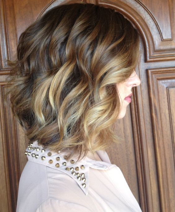 Long brunette a,line bob with balayage highlights and pretty loose curls. Perfect spring