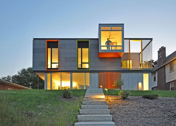 """Johnsen Schmaling Architects were honored for the OS House, set by Lake Michigan in Racine, Wis. The upper part of the exterior is clad in concrete panels; extensive glass connects interiors to the water, while the colorful vertical """"apertures"""" are meant to be a nod to the bright, cheerful Victorian homes in the neighborhood."""