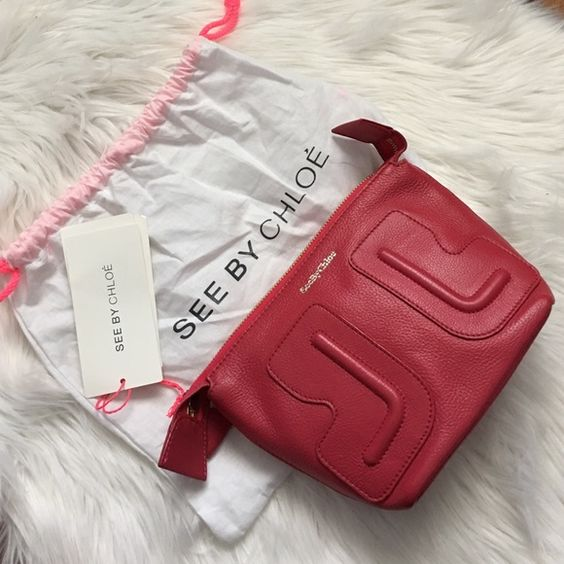 "See by Chloe red cosmetic pouch A soft leather pouch offers chic storage for your every day essentials. Zip top. Lined interior with pocket. Dust bag. Height 6"" x length 8"" x depth 3"". Offers welcome through offer tab. No trades. 33116551 See by Chloe Bags Cosmetic Bags & Cases"