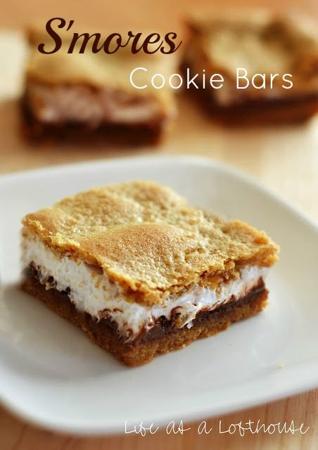 S'mores Cookie Bars---Oh. My. Ya'll, these are unbelievably good. Ooey, gooey, chewy morsels of campfire goodness. The cookie crust has the perfect amount of graham taste and the marshmallow fluff and chocolate bars smushed between the cookie layers are perfectly rich. Make these! You won't be sorry!