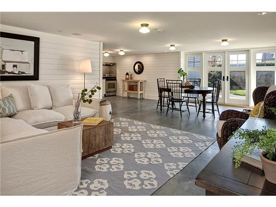Daylight Basement With Light Colored Walls And Furniture