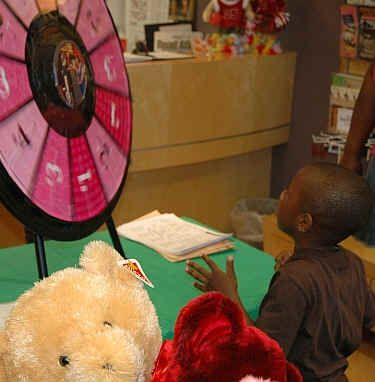 a young spinner takes a spin on the Prize Wheel