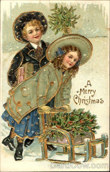 """Antique """"A Merry Christmas"""" postcard. Boy is holding mistletoe, the girl is pushing a wagon,with holly.:"""