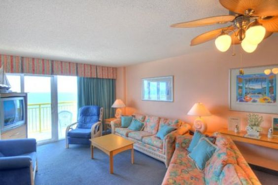 Living area with oceanfront balcony.  Bay Watch Resort Condos for Sale - North Myrtle Beach, SC  #baywatchresort  http://www.c21theharrelsongroup.com/bay-watch-resort/