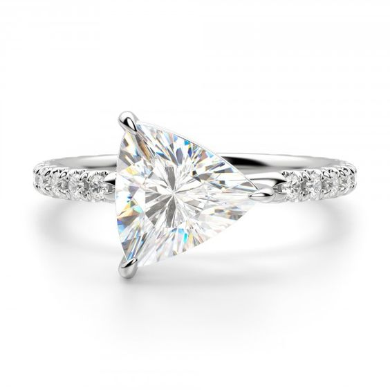 A trendy take on timeless. The East-West Accented Trillion sets a traditionally vertical Contemporary Nexus Diamond™ on its side. It is a study in duality. Classic, yet modern. Strong, yet feminine. Simple, yet luxurious. Like a modern woman, it defies a single category. And the look? Sumptuous in its detail, from the accented band to the intertwined double-claw prongs. It is a ring that commands a second, then a third, look. Center stone pictured: 1.92 carat Trillion cut, 2.25 total carat w...