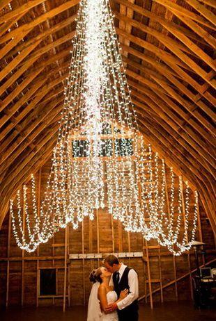 Elegant wedding string lights backdrop romance in wedding.: