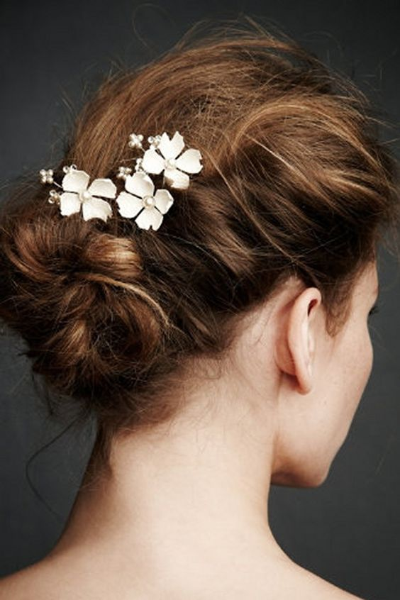 With wedding season almost underway, we have been craving all that comes along with it: the gowns, the locations, the hair, the beauty looks, and a personal favorite — hair accessories! Now bridal hair accessories are not limited to just a simple gown. Take a peek through our slideshow above to see some of the Read More >>