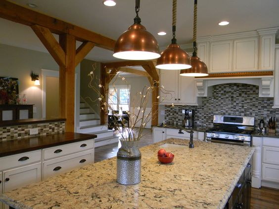 Kitchen adorned with copper accents and custom lighting