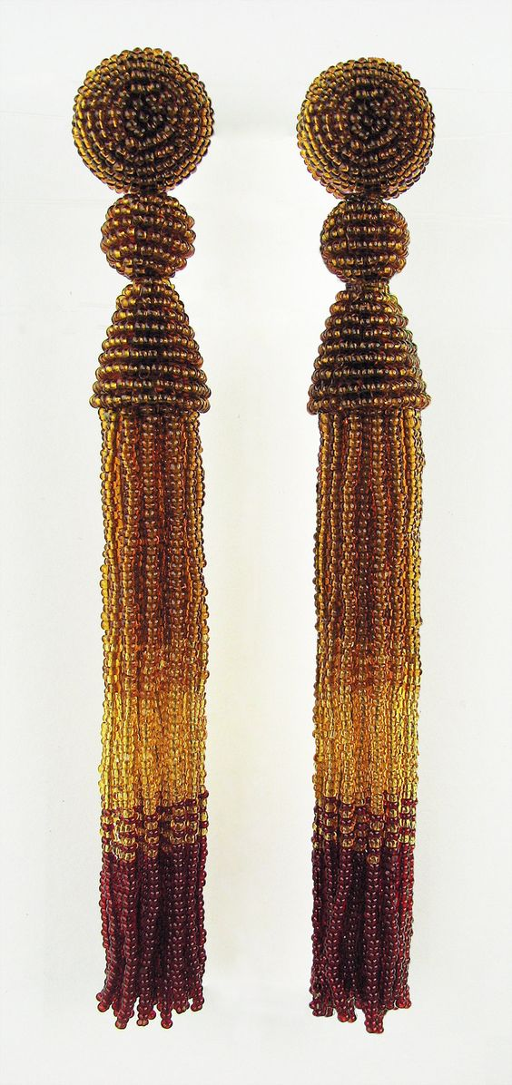 Autumn Red and Gold Tassel Earrings by Julie Long Gallegos. Tiny Charlottes, the queen of seed beads, manufactured under strict control in the Czech Republic, are used to create these long and sinuous tassel earring for pierced ears in two shades of gold and deep red. For pierced ears, these are amazingly lightweight, and have a sinuous sway to complement your neck and shoulder, as well as hairstyle. Comfort disk backs and sterling silver posts. 18mm (5/8