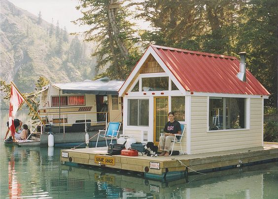 BoatsInstead of putting the fishing shack into storage every summer  put it on a raft   plastic barrels to float it and an outboard motor for cruising around