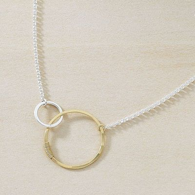 Love these symbolic mother necklaces that are more subtle than a name necklace. And affordable!