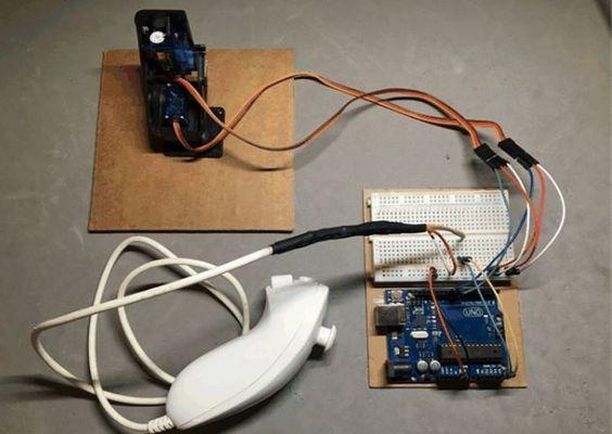 Control pan/tilt servos using hacked Wii nunchuk and Arduino  https://www.hackster.io/mtashiro/control-servos-using-wii-nunchuk-9136bd