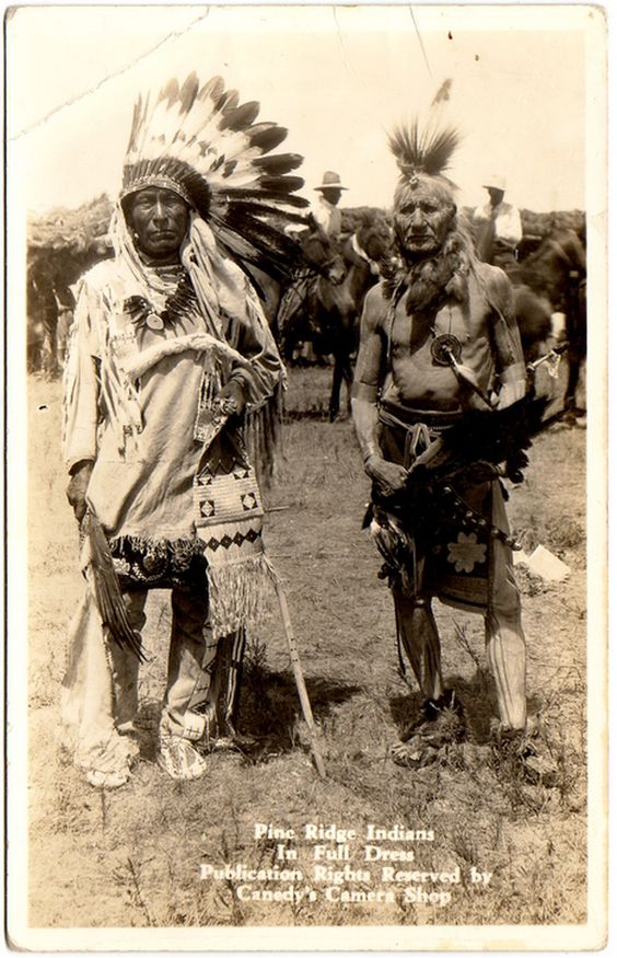SIOUX Lakota Miniconjou Iron Hail (Dewey Beard), and unidentified Indian, Pine Ridge Reservation, early 1900s. Real Photo Postcard published by Canedy's Camera Shop and edited c.1940-1950.