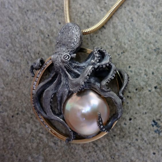 Custom design Octopus pendant in gold and silver with diamonds and a pearl. Realistic, handmade jewelry, cast and finished in USA.