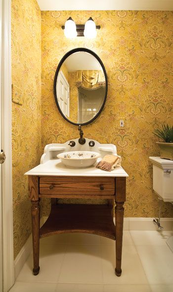 The Powder Room S Furniture Style Vanity With Vessel Sink Impresses With Its