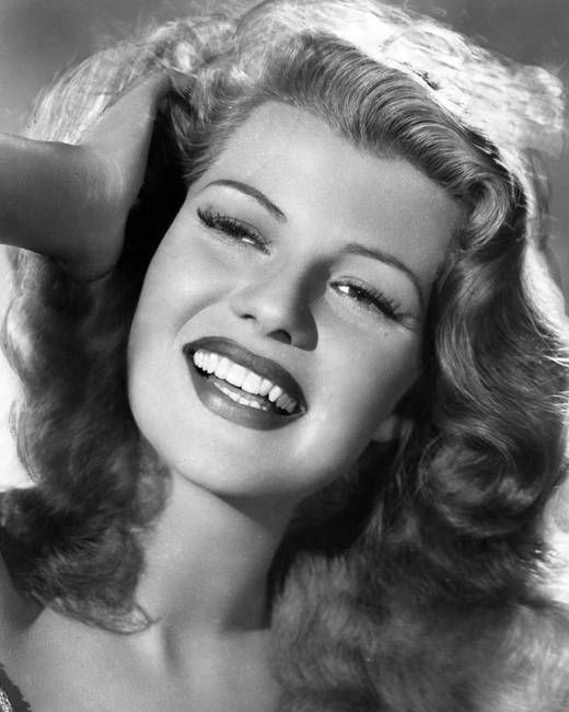 Rita Hayworth hand in hair by Retro Images Archive