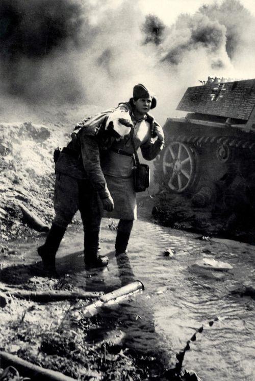 A Soviet nurse in action on the battlefield, 1943.