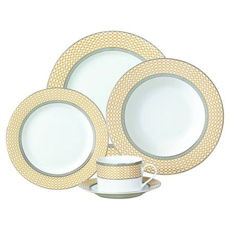 Create a lovely tablescape with this earthenware dinner set, featuring a link-print rim for stylish appeal.     Product:
