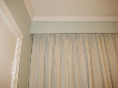 Header and molding to hide curtain rod or panels