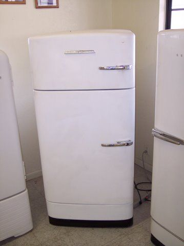 THE fridge. 1950's General Electric, white, horizontal door opener.  Freezer on top. It would be better if the handles were on the other side.