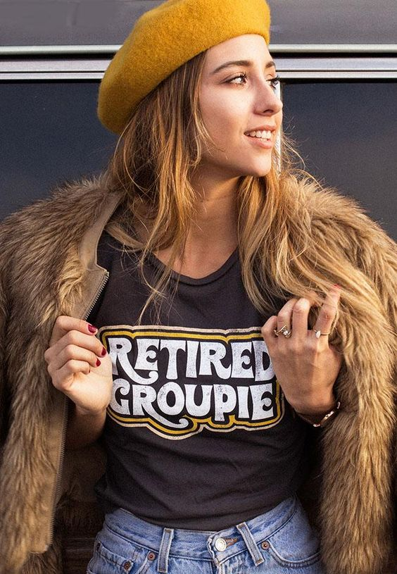 "For our fellow (ex) bandaids- our new Retired Groupie graphic tee. This vintage inspired tee has 70's style design on front. Blank back. These tees are fitted. We suggest sizing up if you are in between sizes or prefer a looser fit. - 100% cotton - ""vintage"" black - Model is wearing a size small - Cut, sewn, dyed and printed in Los Angeles. Sweatshop free Measurements- taken flat (chest width) Small- 16"" (32"" doubled) Medium- 17"" (34"" doubled) Large- 18"" (36"" doubled) XL- 19.5"" (39"" doubled) XXL- 20.5 (41"" doubled)"