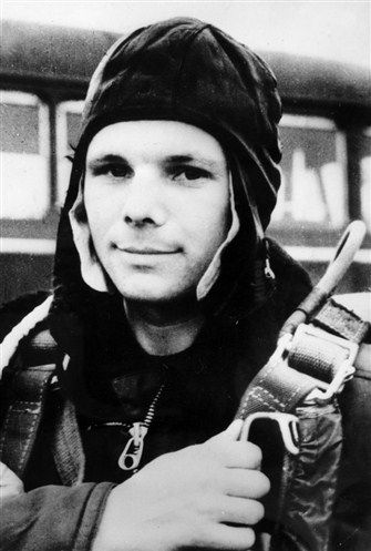 Yuri Gagarin (1934 – 1968), a Russian cosmonaut, the first human in space, at the airfield in his Air Force uniform with a parachute. 1961. #Russia #cosmonaut #Yuri_Gagarin