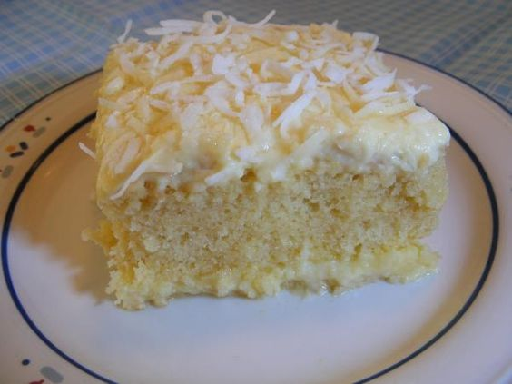 Moist Coconut Pudding Cake from Food.com:   								AWESOME!!  As each day goes by this pudding cake mellows and gets better.  A very moist cake with a creamy custard on the bottom.  This cake is lighter than it appears and would be a good after dinner dessert for guests.