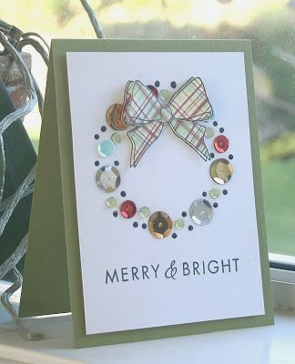 handmade Christmas card from Hey There .... rosigrl!: merry & bright ... clean and simple ... wreath of sequins and dots with a paper pieced bow of plaid print ... like it!