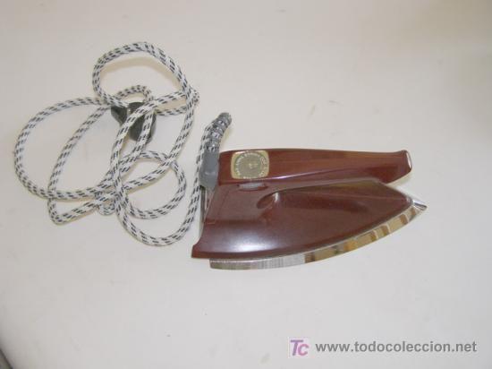 Plancha de bakelita marca HUSQVARNA, años 60-70 18 €