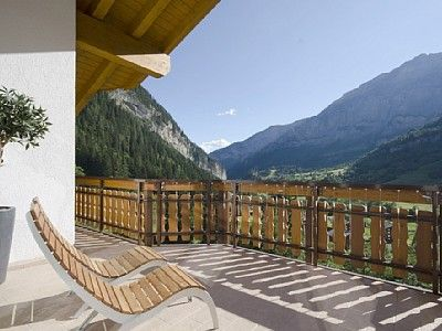 Penthouse complex in southern Switzerland. Nestled in the middle of mountains with a lake nearby for summer water activities. Located in Leukerbad, known for its hot springs spas