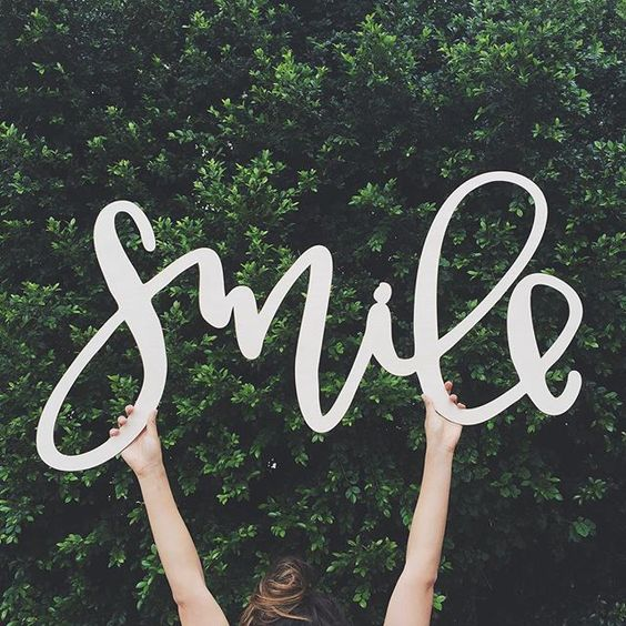 Smile Lasercut Sign.jpg
