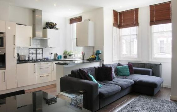Open plan kitchen and living room the long sofa is a great way of dividing the room ways to for How to divide a kitchen and living room