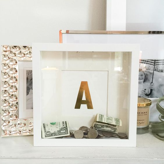 Easy #IKEA shadow box frame coin bank! I've been looking for piggy banks for my girls. Not that they don't have piggy banks already but they are always getting into theirs. This one is hard to get...:
