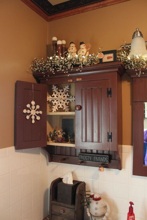 September 061; prim bathroom decor; sweet snowflakes, snowmen, and white garland