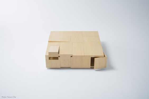 The Kai Table by Tokyo-based designer Naoki Hirakoso and Takamitsu Kitahara has a lot of hidden drawers