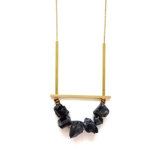 Six raw black tourmaline stones on a vintage brass chain with thin square brass bars   Sarah Safavi Jewelry
