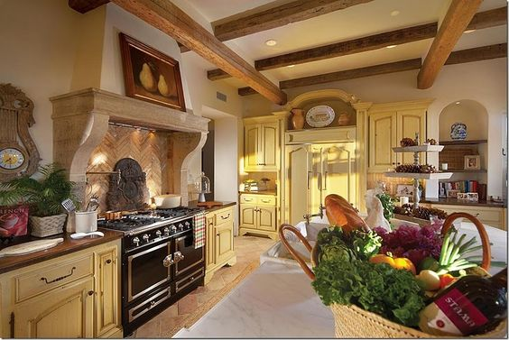 Above the range is another beautiful mantel with a herringbone patterned brick backsplash.  The refrigerator is to the right behind cabinet doors.