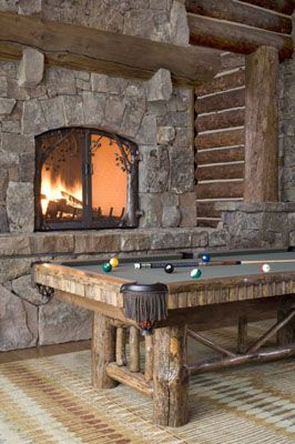 game room in the rustic log vacation home  Game Room    http://homerepairexpert.com/how-to-build-a-stone-dry-wall    www.homerepairexpert.com