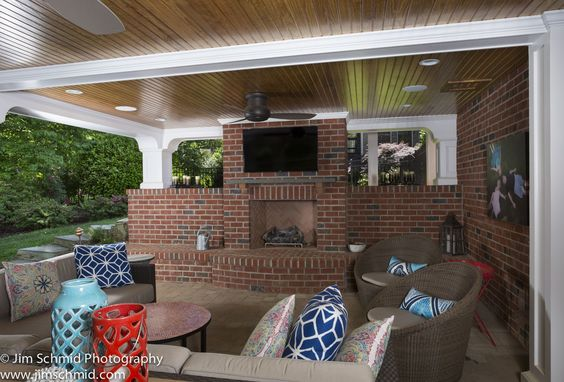 #patio #porch #covered patio #fireplace #outdoor fireplace #wood burning fireplace #pillows #candles #wicker seating #wicker furniture