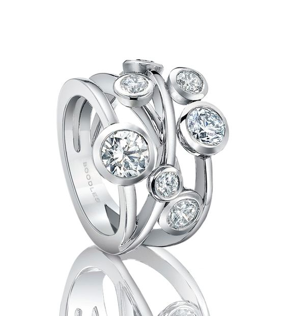 Raindance Anniversary Ring. In platinum with 2.09ct diamonds   EUR 16,500  A contemporary diamond ring.   Set with a certificated round-brilliant cut diamond of 0.70ct and a further 1.39ct of diamonds in a platinum rub-over setting on an entwined multi-strand band.